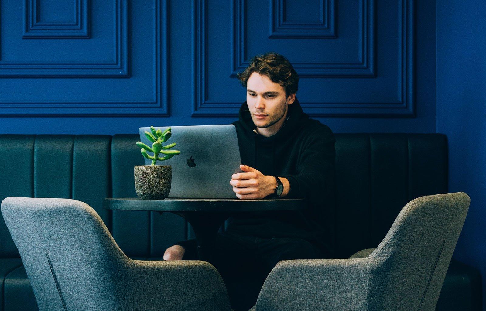 person sitting behind laptop