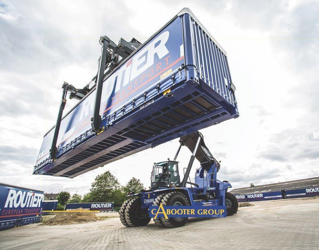 blue reachstacker lifting a blue container